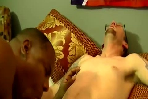 Nerdy Tattoed lad bonks A big black fellow