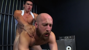 Short haired Axel Kane bareback spanking in the prison