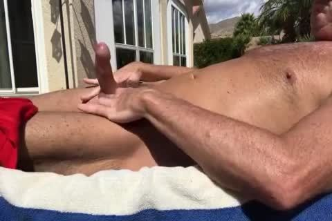SUNBATHING WITH HARD ramrod OUT AND wanking